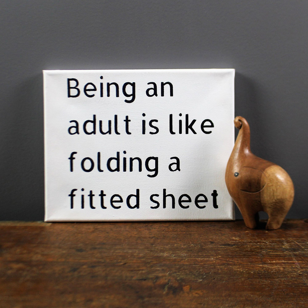 Being an adult is like folding a fitted sheet Canvas Sign